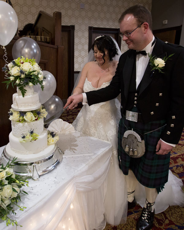 Bride and groom cutting cake Pastures Lodge Mexborough Wedding Photographer