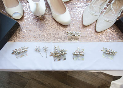 A selection of accessories on a white table cloth at Harriet Wilde shoe and accessory event March 2017