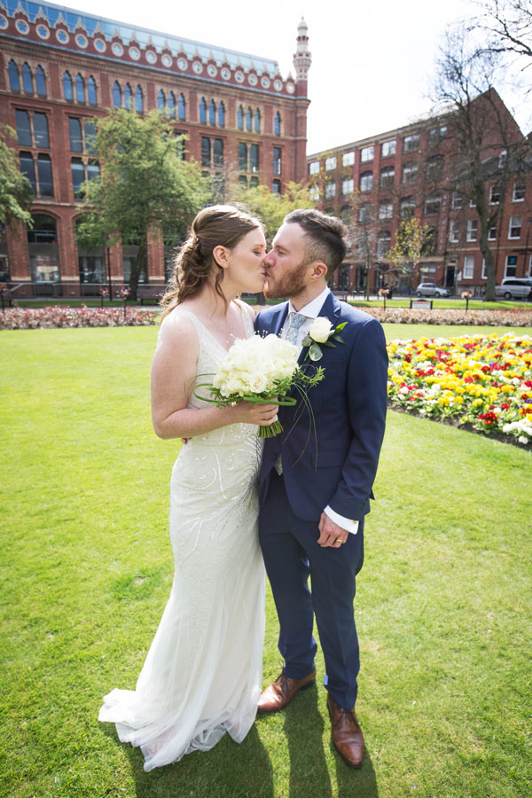 Bride and Groom kiss at park square Leeds