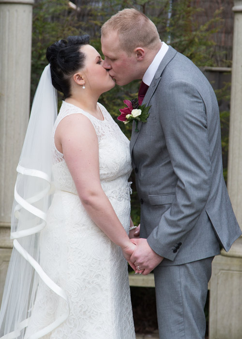 Bride with floor length veil kissing groom at Holiday Inn Barnsley