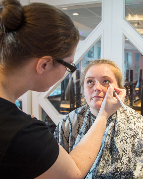 Nicola Whitfield applying makeup to a model at Rigby suite Barnsley