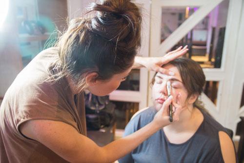 Gemma Louise makeup artist applying makeup to model in Rigby Suite Barnsley