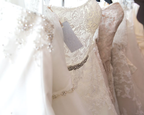 Wedding dresses hanging in a row