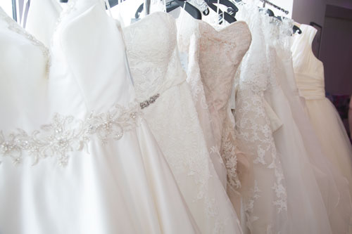 Wedding dresses from Marie Blanche Bridal hanging in a row