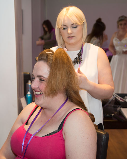 Model having hair done at the Marie Blanche Bridal catwalk event