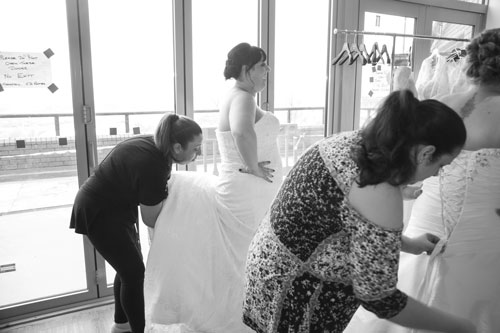 Finishing touches being made to models outfits at the Marie Blanche Bridal event