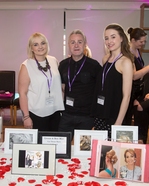The staff from Bentleys hair salon at the Marie Blanche Bridal catwalk show with their stand