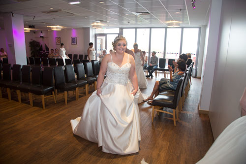 Model smiling at camera from the catwalk Rigby suite banrlsey