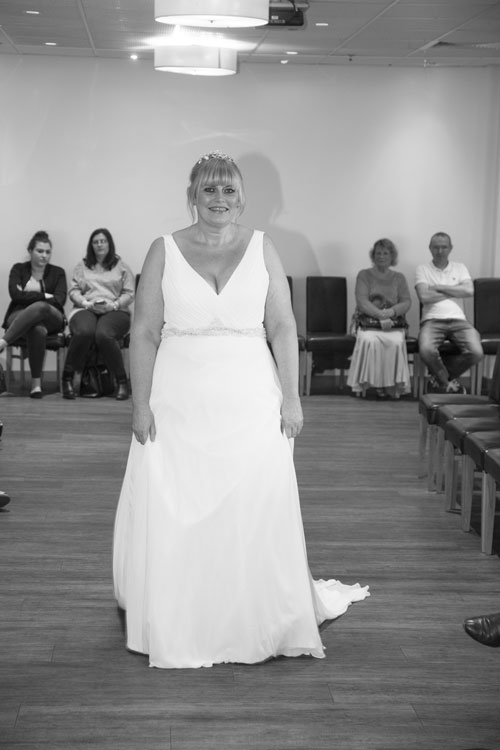 Model smiling at camera from the catwalk in the Rigby suite Barnlsey