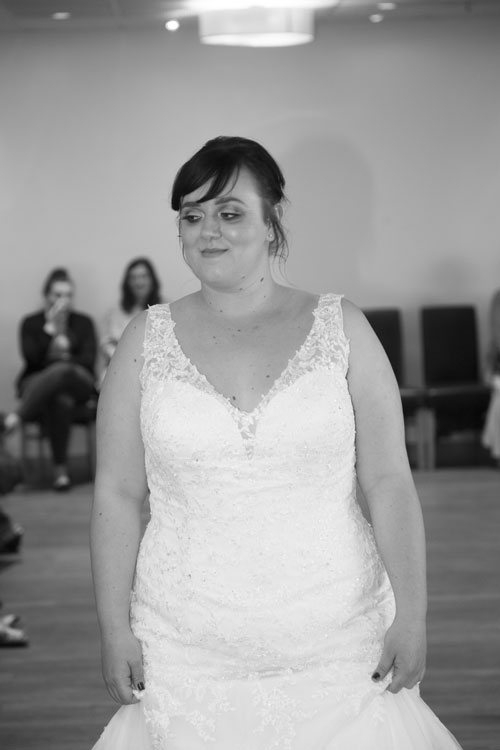 Model smiling from the catwalk in the Rigby Suite Barnsley