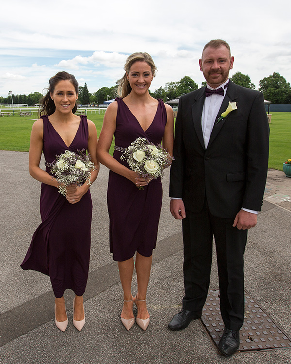 Bridesmaids in purple dresses and groomsman in purple bow tie waiting for the bride at the Old Weighing room Doncaster racecourse