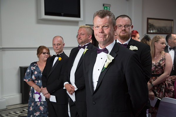 Groom waiting for bride at front of ceremony room the Old Weighing Room Doncaster Racecourse