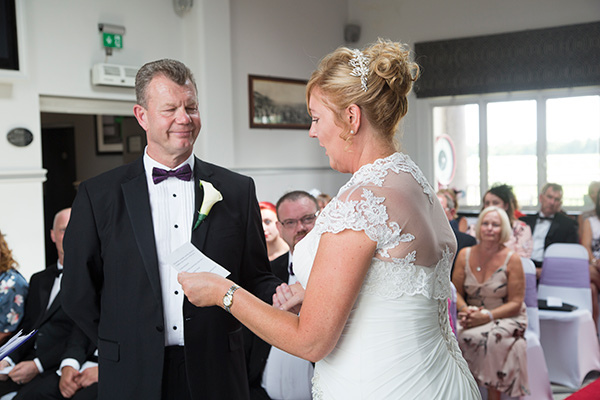 Bride reads hand written wedding vows to Groom during their wedding ceremony at the Old Weighing Room Doncaster racecourse