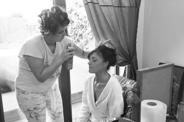 Bride having hair and makeup done on the morning of her wedding