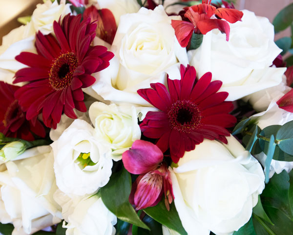 Red white and green wedding flowers close up