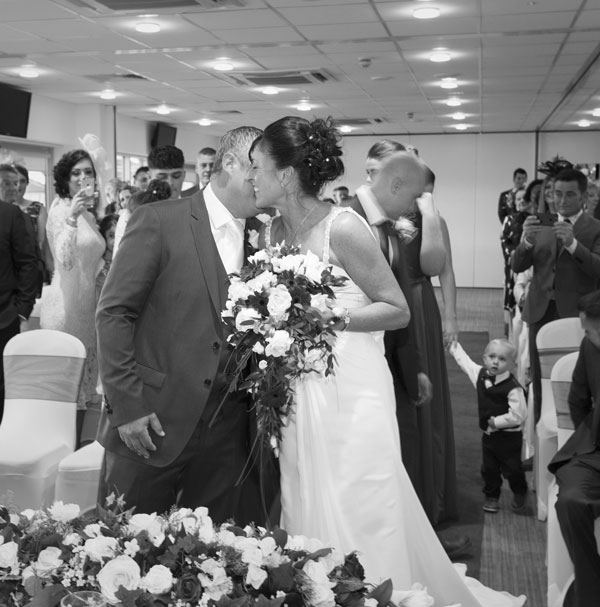 Bride and Groom meeting on the aisle at New York Stadium Rotherham