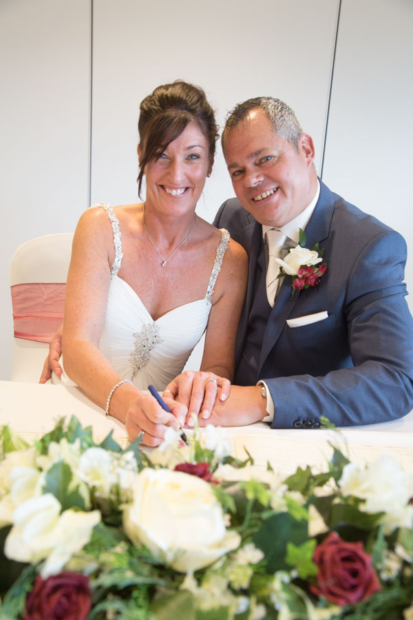 Bride and Groom signing the register Aesseal stadium Rotherham