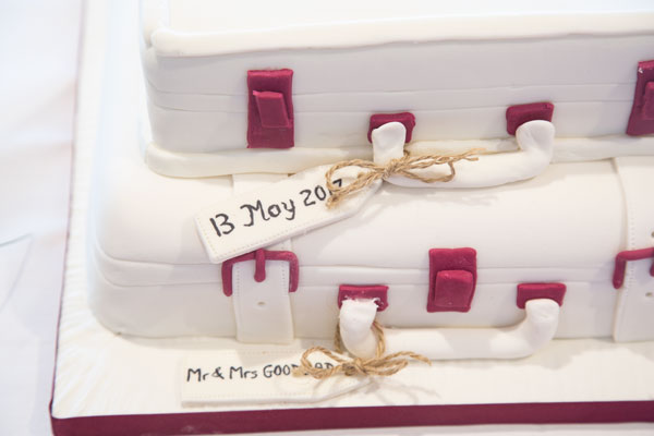 Luggage theme wedding cake with brown tags