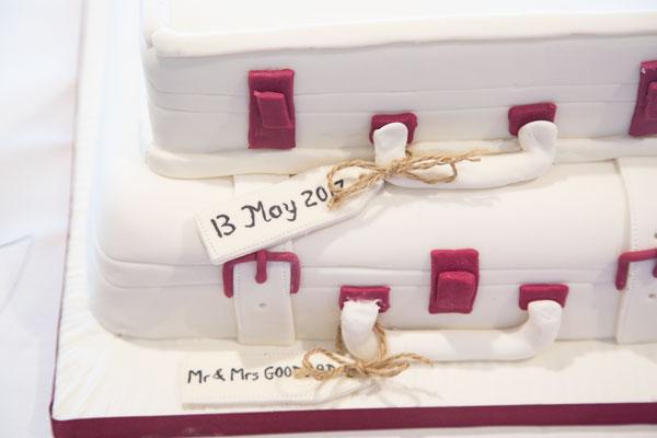 Luggage theme wedding cake with brown tags
