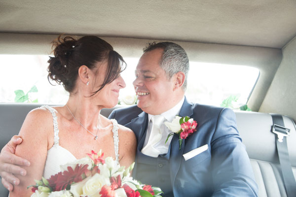 Bride and Groom in Wedding car looking at each other outside New York Stadium Rotherham