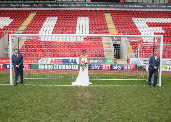 Bride with Groom and Groomsman in the goal at New York Stadium Rotherham