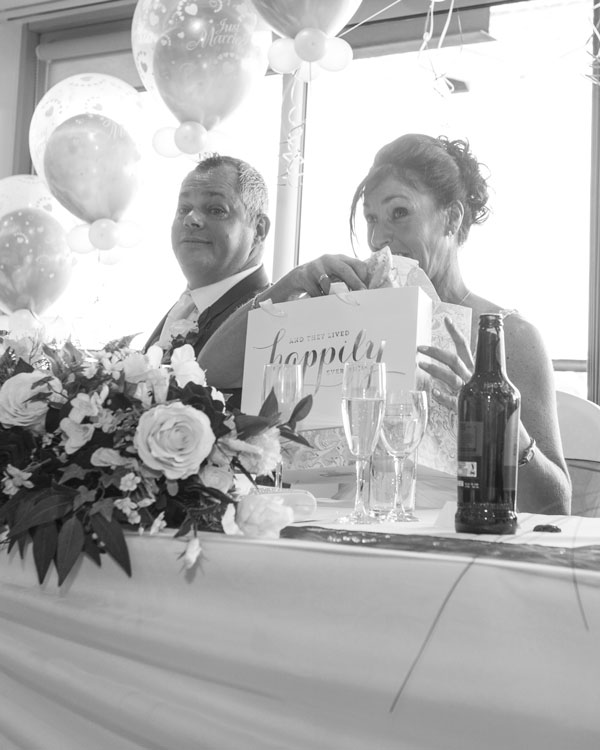 Bride recieving a gift at the top table during the speeches