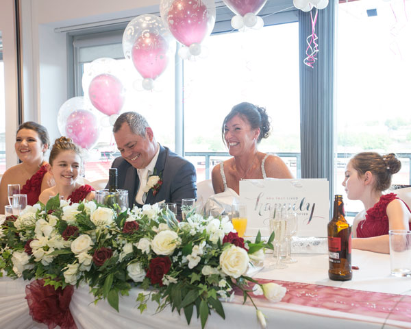 Bride and Groom laughing on the top table during the speeches