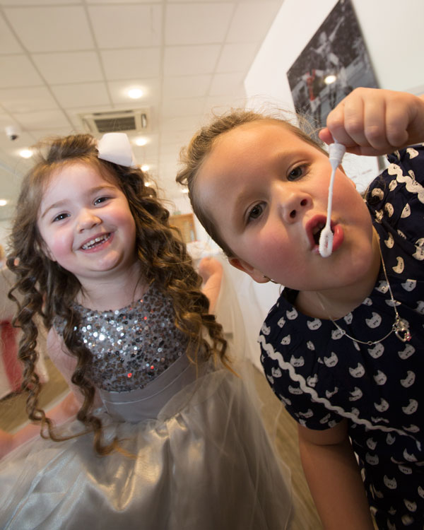Girls at the wedding blowing bubbles into the camera