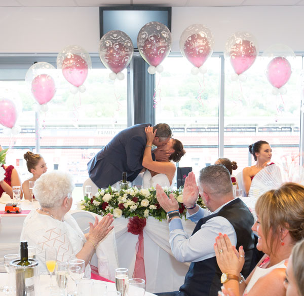 bride and Groom kiss at top table