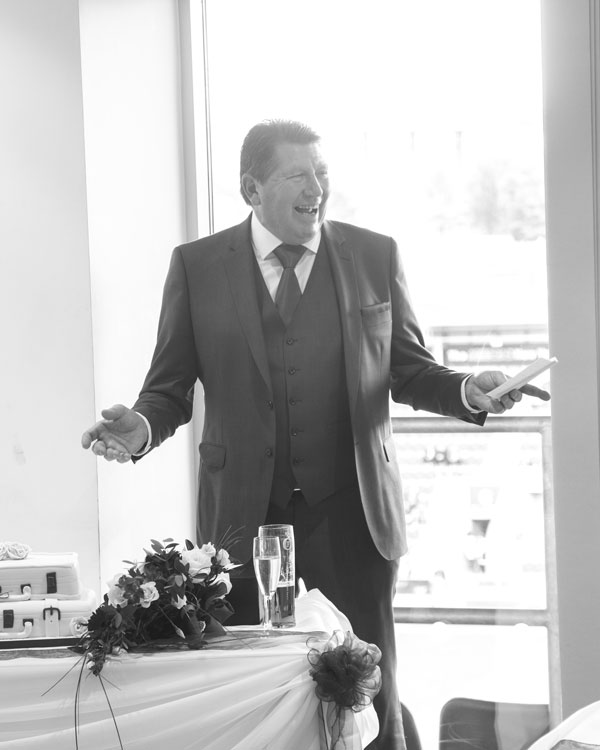 Best man in black and white giving speech at Donna and Pauls wedding