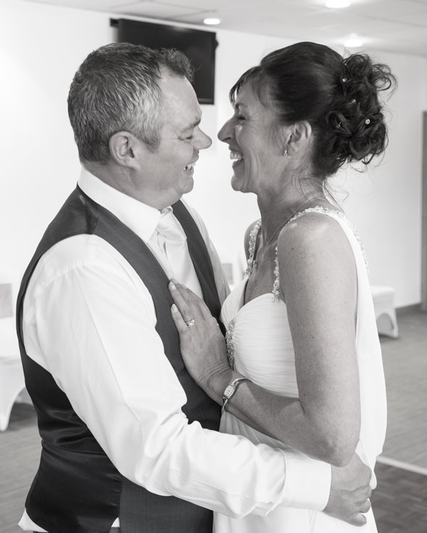 Bride and Groom laughing during their first dance New York Stadium Rotherham