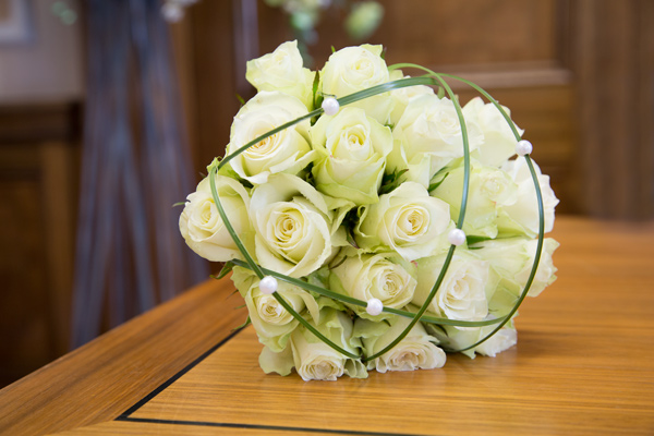 White rose wedding bouquet on brown table in Barnsley town hall