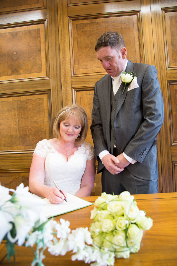 Bride and Groom signing the register at Barnsley Town Hall