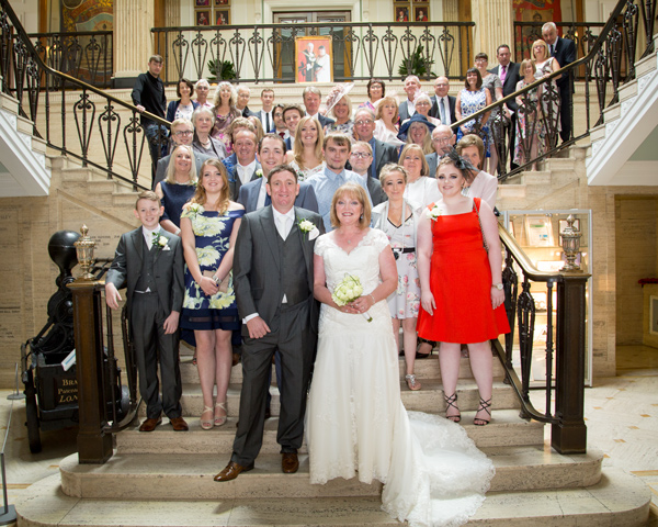 Bride and Groom with all their guests on the staircase inside Barnsley Town Hall