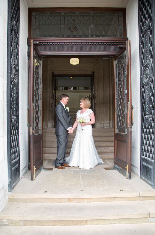 Bride and Groom pause in the doorway while leaving Barnsley Town Hall wedding