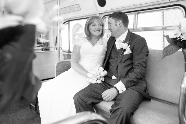 Bride and Groom on the seat of the bus in Black and White