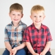Two boys in cheqyered shirts smiling at the camera during a barnsley mini session