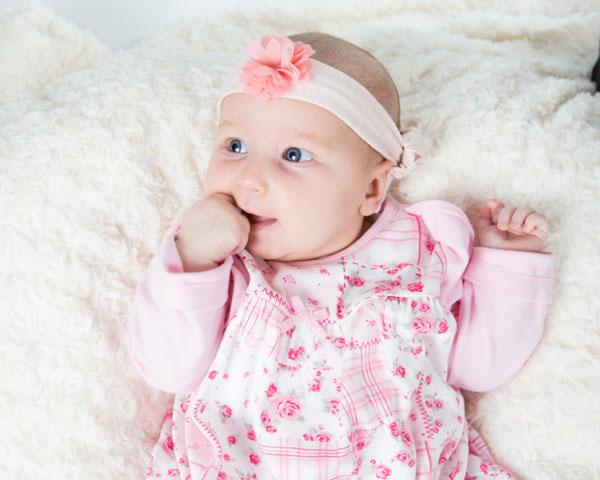 baby girl in pink looking left