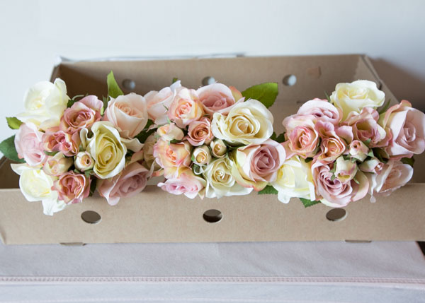 Three bridesmaid bouquets in the cardboard box they arrived in