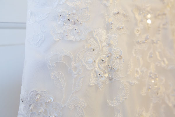 Close up of the bead detail on the wedding dress