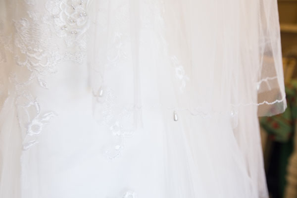 Close up of the pearl detail on the wedding veil