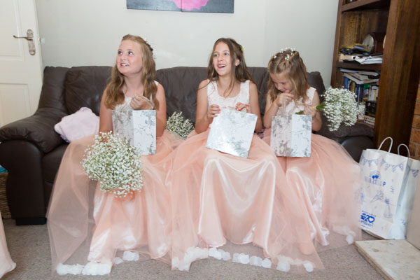 Flowergirls opening gifts on the morning of the wedding
