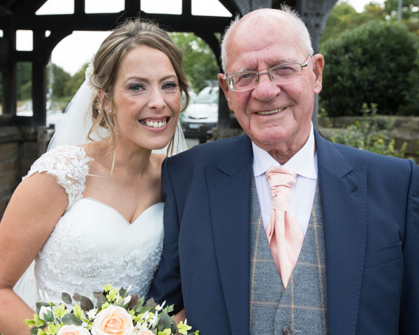 Bride and her Grandad walking to the Church