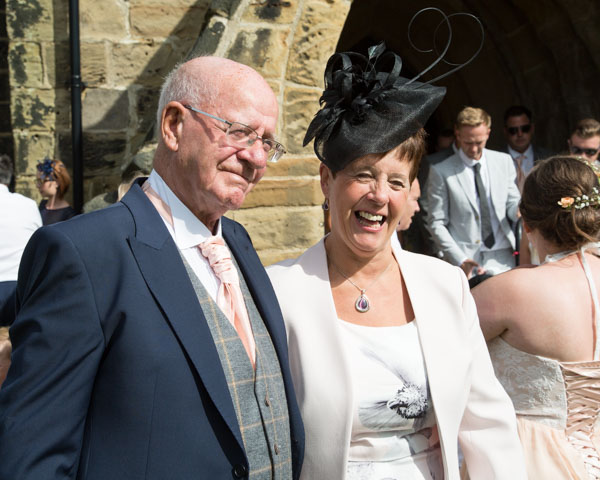 Mother of the Bride and Brides Grandad outside Shafton church laughing