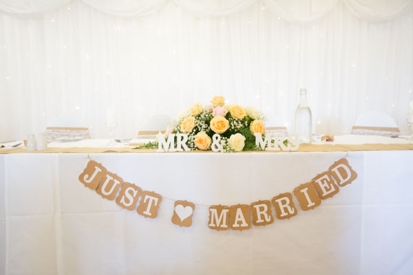 Just married and Mr & Mrs sign at the top table at Shaw Lane Sports Club