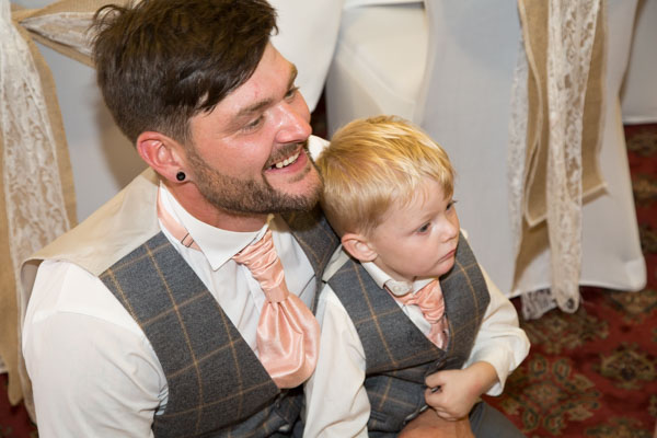 The Groom and his son watching Brendini in matching waistcoats and cravats