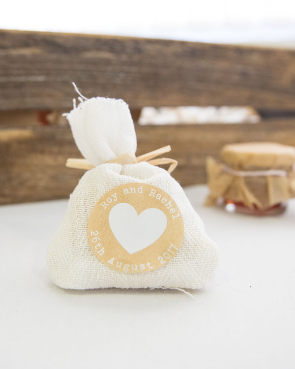 Wedding favours in hessian bags finished with personalised stickers