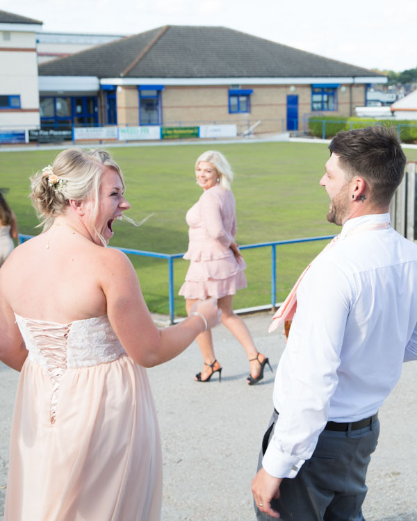 Maid of Honor laughing with the Groom at Shaw Lane Sports Club Barnsley