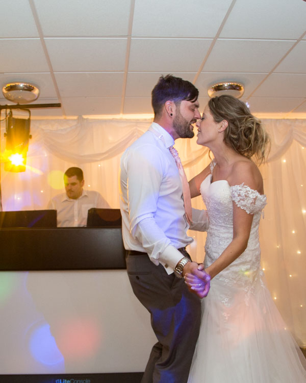 Bride and Groom singin to each other during their first dance at Shaw Lane Sports Club Barnsley