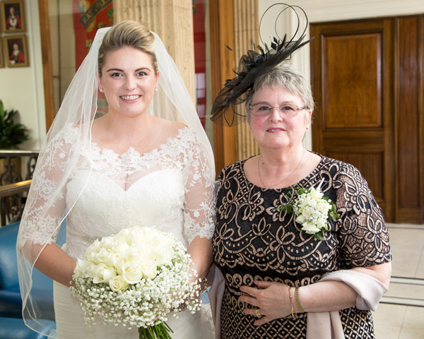 Bride and Mother of the Bride smiling for the camera in Barnsley Town Hall on the wedding day bespoke wedding photography